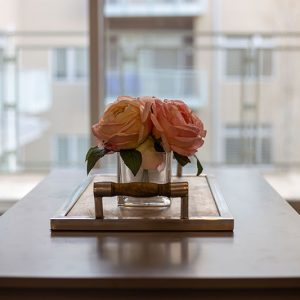 Artistic image of roses on table